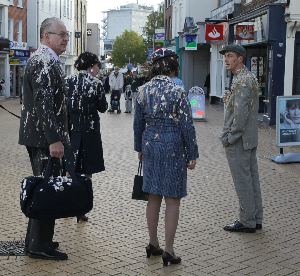 people covered in bird droppings